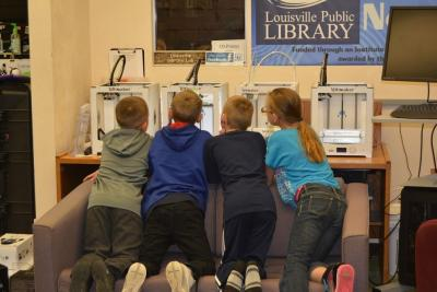 Kids watch the 3D Printer at work.